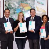 The moment the Free Zone Team presents Minister de Meza its new general information investment brochure.